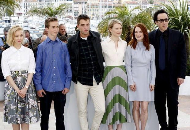 Sarah Gadon, Evan Bird, Robert Pattinson, Mia Wasikowska, director David Cronenberg, Julianne Moore, and John Cusack at the Map to the Stars photo call during the 67th Annual Cannes Film Festival in Cannes, France, on May 19, 2014