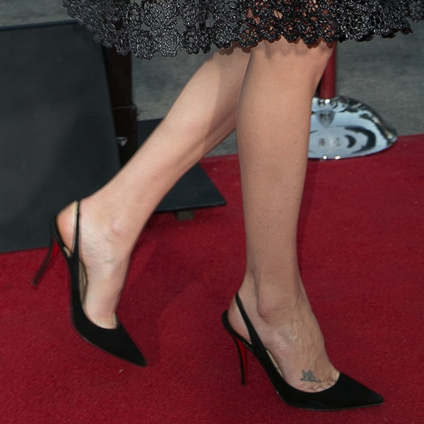 Charlize Theron wearing Christian Louboutin slingback pumps