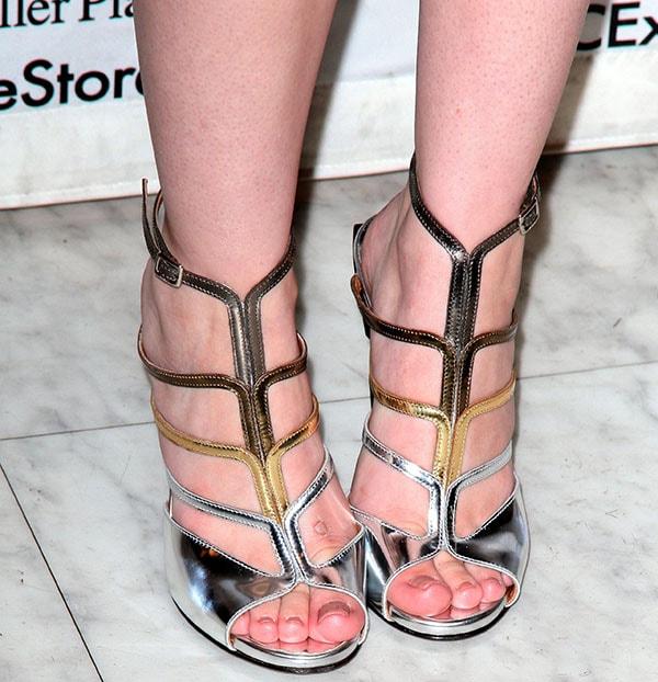 Cher Lloyd in strappy metallic sandals by Fendi