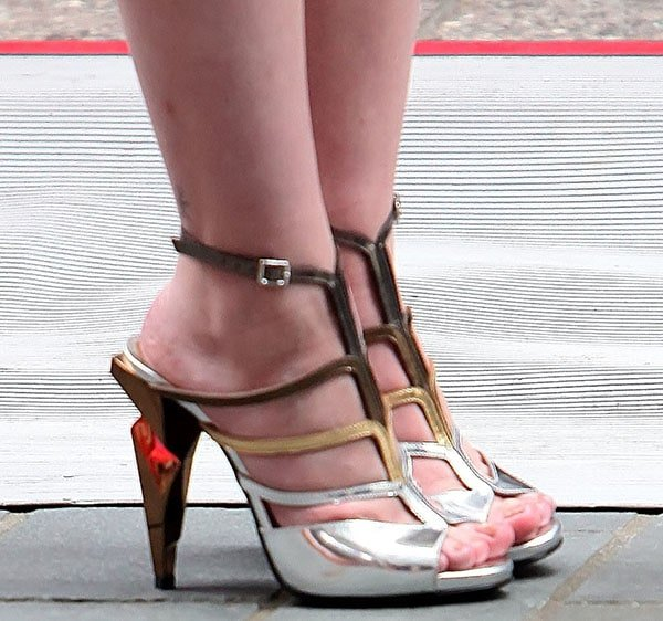 Cher Lloyd in a pair of tri-tone metallic heels by Fendi while performing at the Rockefeller Plaza in New York City on May 27, 2014