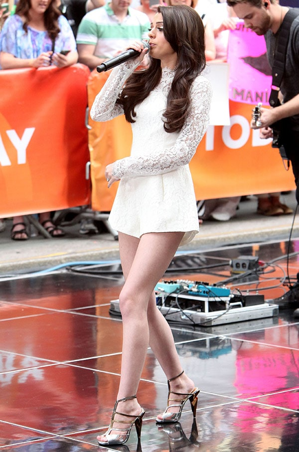 Cher Lloyd wore the tri-tone strappy sandals with a very feminine white lace romper that covered up her tattoos