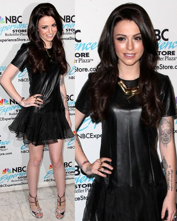 Cher Lloyd in little black leather dress with short sleeves and a sheer skirt overlay