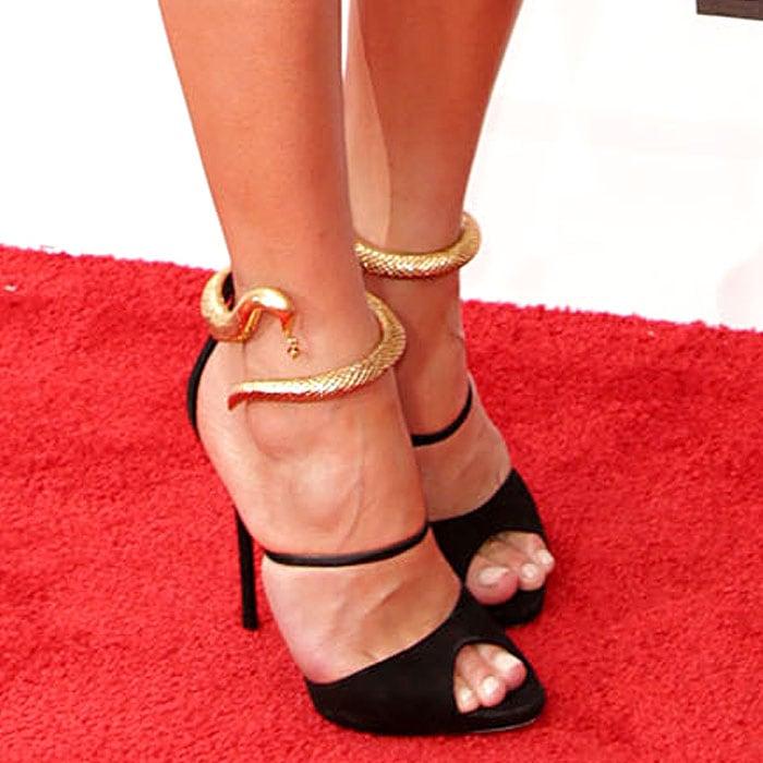 Chrissy Teigen wearing Giuseppe Zanotti gold-snake-cuff suede sandals