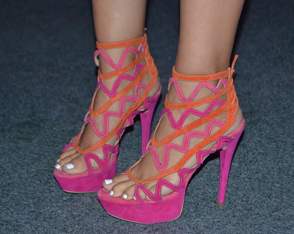 Didi's hot feet in orange-and-pink sandals