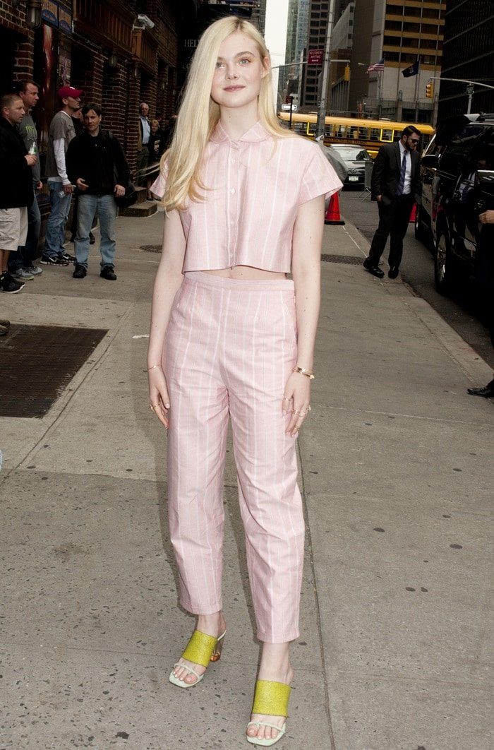 Elle Fanning wore a pink striped crop top with matching pants that looked like pajamas