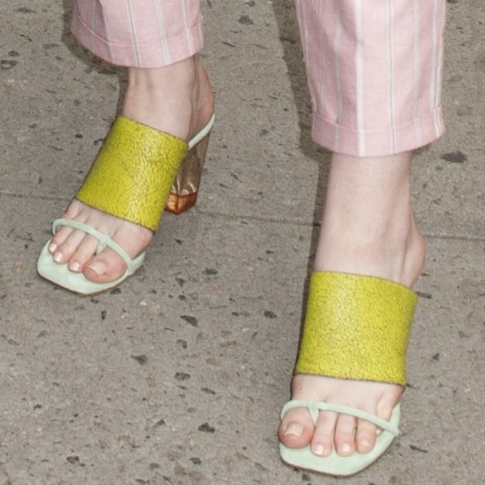 Rounding off her look were striking sandals that feature wide crackle leather midstraps in yellow, front straps with thong toe straps in mint green, and about 3 inch clear Lucite heels