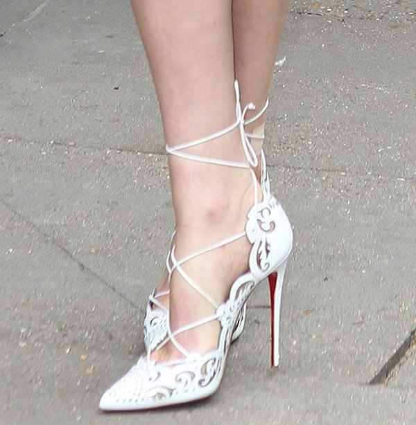 Florence Welch wearing white Christian Louboutin Impera pumps
