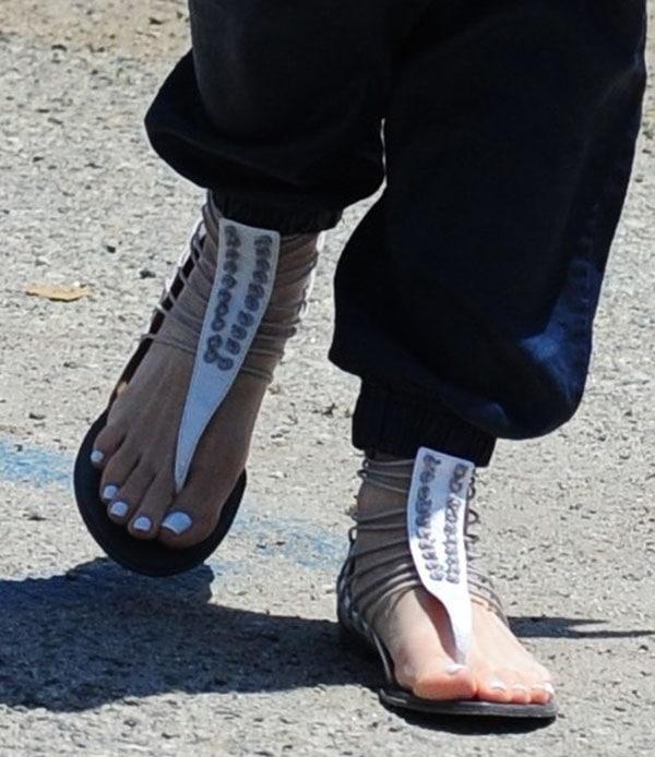 Gwen Stefani wearing L.A.M.B. sandals