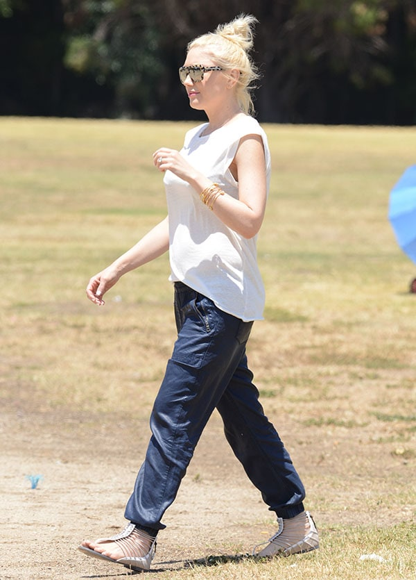 Gwen Stefani wore a simple white tee and a pair of blue cargo pants