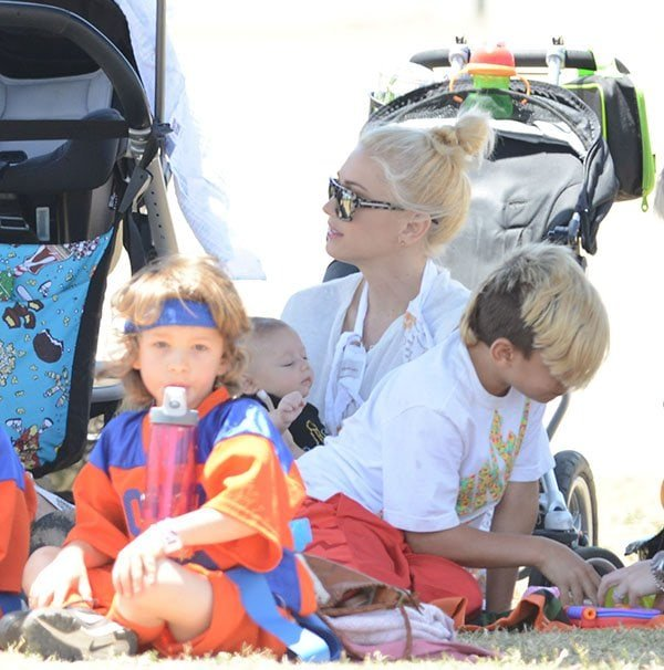 Gwen Stefani and new baby Apollo Rossdale watch Stefani's older sons play sports