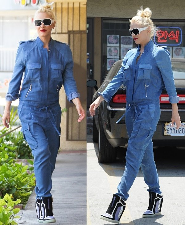 Gwen Stefani in a loose-fitting jumpsuit from L.A.M.B. featuring a drawstring waist and two silver zippered pockets on the front