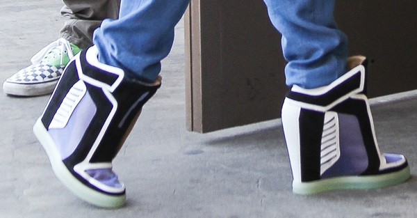Gwen Stefani wearing wedge fashion sneakers