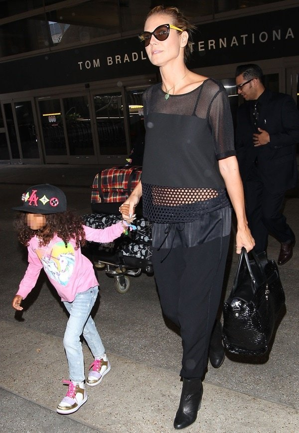 Heidi Klum and daughter Lou Samuel arriving at Los Angeles International Airport (LAX) on May 10, 2014