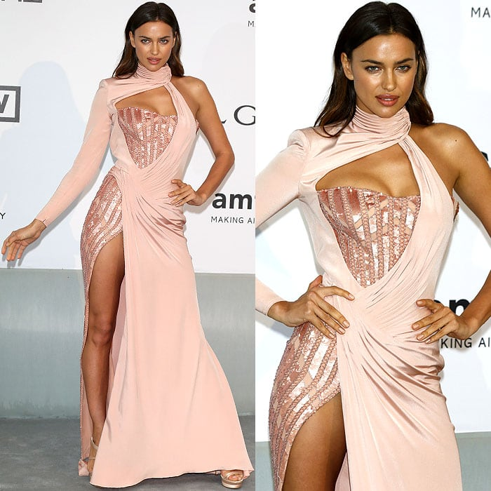 Irina Shayk striking some fierce poses in her Atalier Versace gown and Versace sandals
