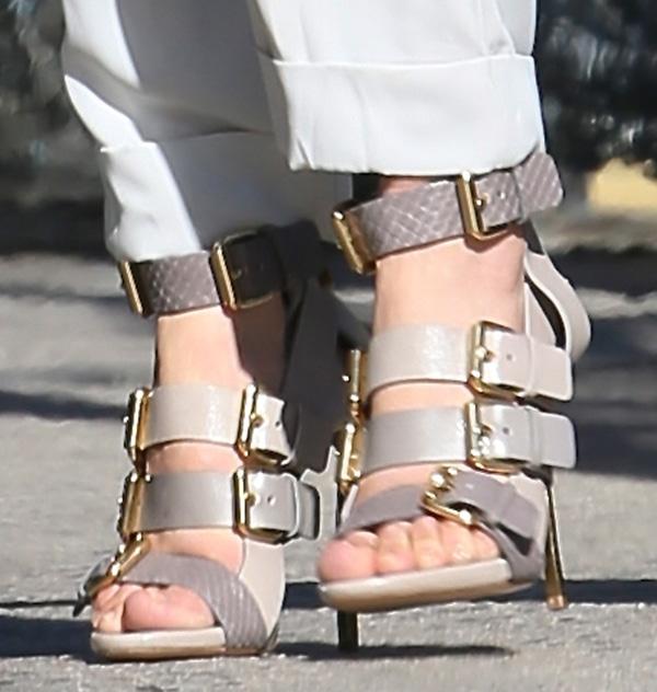 Jennifer Lopez shows off her feet in gold-tone blade stiletto heels