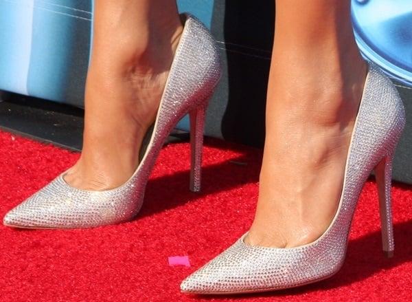 Jennifer Lopez wearing Jimmy Choo glitter pumps
