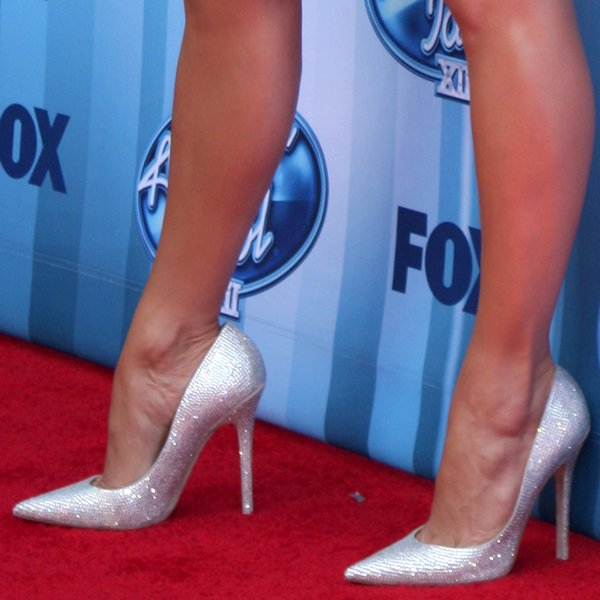 Jennifer Lopez showing off her legs in glittering Jimmy Choo pointy-toe pumps