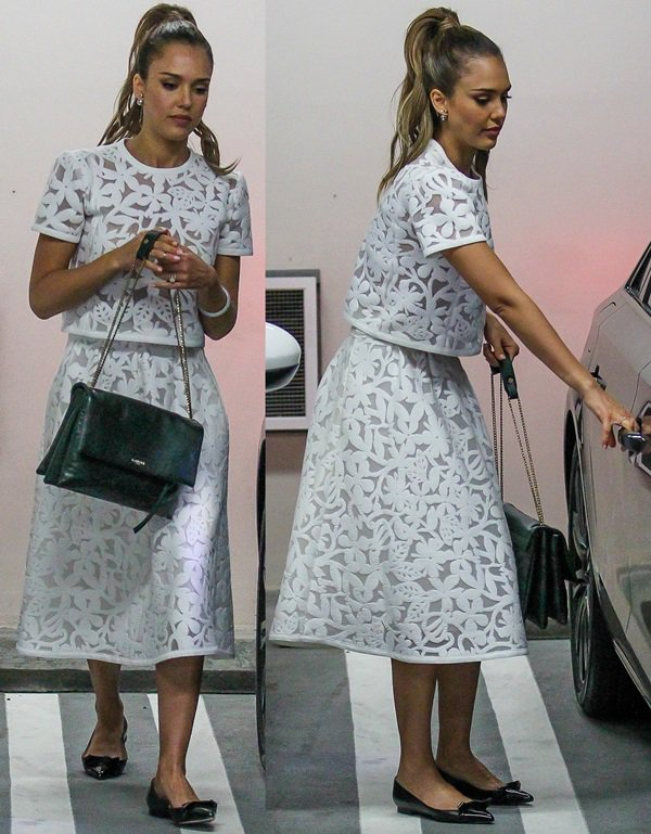 Jessica Alba wearing a floral mesh crop Bora top and a Madison skirt from Toronto-born designer Tanya Taylor
