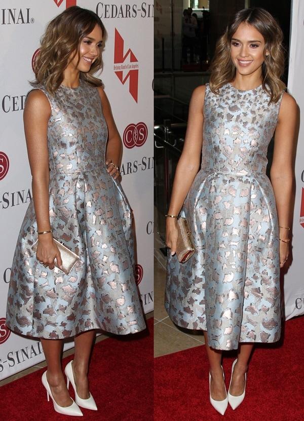 Jessica Albain a jacquard lamé sleeveless dress from the Mary KatrantzouFall 2014 collection