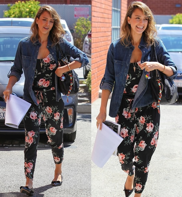 Jessica Alba in a gorgeous black floral jumpsuit by Michael Lauren covered in a pattern of colorful roses