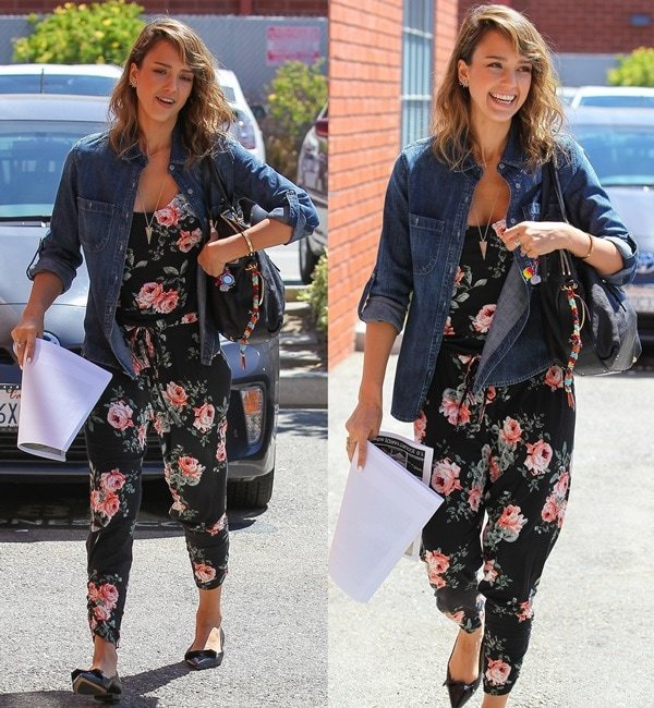 Jessica Alba ina gorgeous black floral jumpsuit by Michael Lauren covered in a pattern of colorful roses