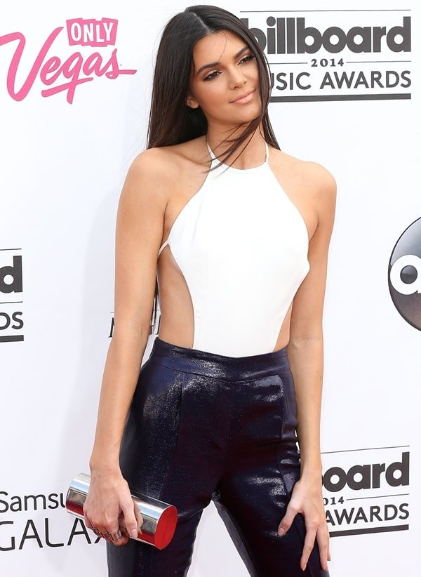 Kendall Jenner's white racer front top and a Jimmy Choo clutch