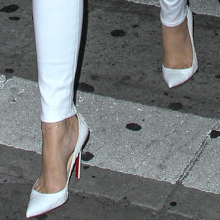 Khloe Kardashian's sexy feet in white Christian Louboutin Pigalle python pumps