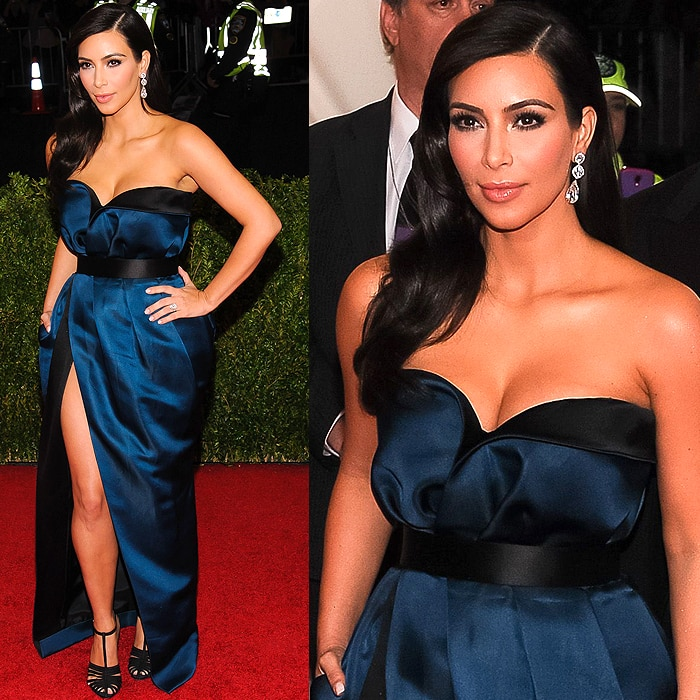 Kim Kardashian sporting the sleek satin belt and the strappy t-strap sandals she changed into on the red carpet at the 2014 Met Gala