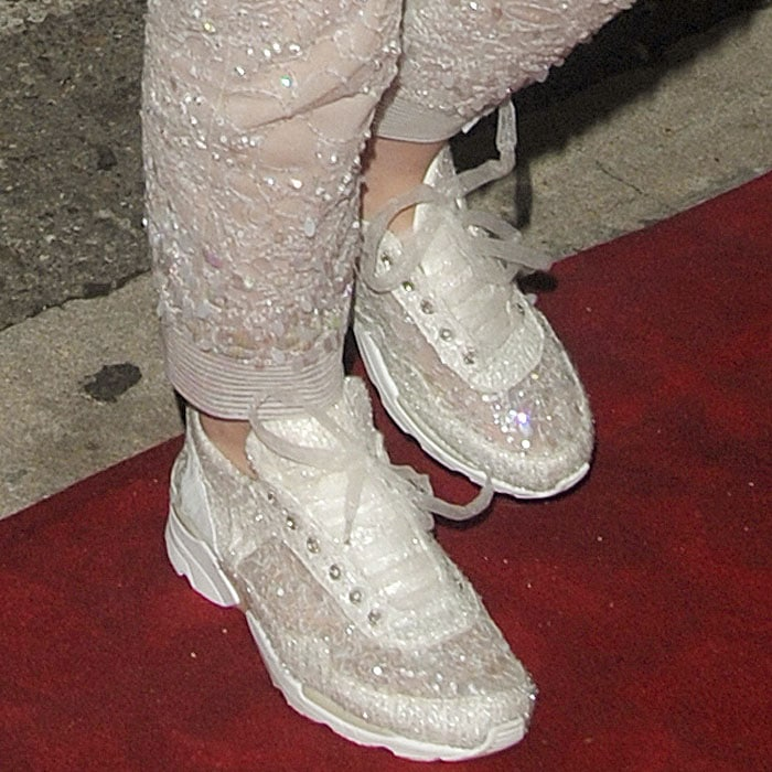 Kristen Stewart'ssequined and embroidered semi-sheer sneakers