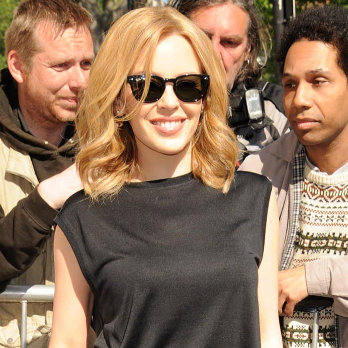 Kylie Minogue capped off the combination with dark sunnies and barely there jewelry