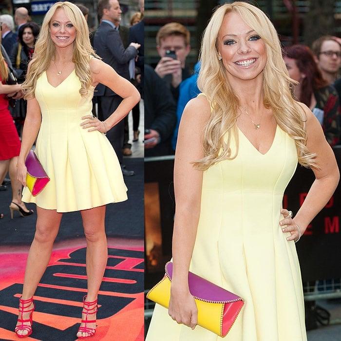 Liz McClarnonina pale yellow flared dress at the premiere of 'Godzilla'
