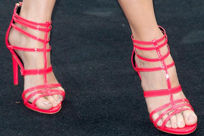 Liz McClarnonin bright pink River Island cage sandals