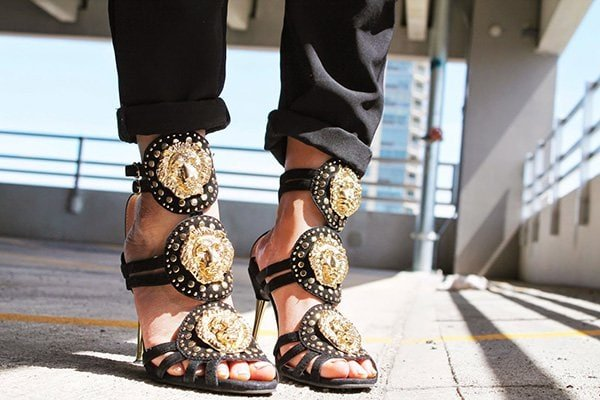 Mai's shoes with lion head medallions
