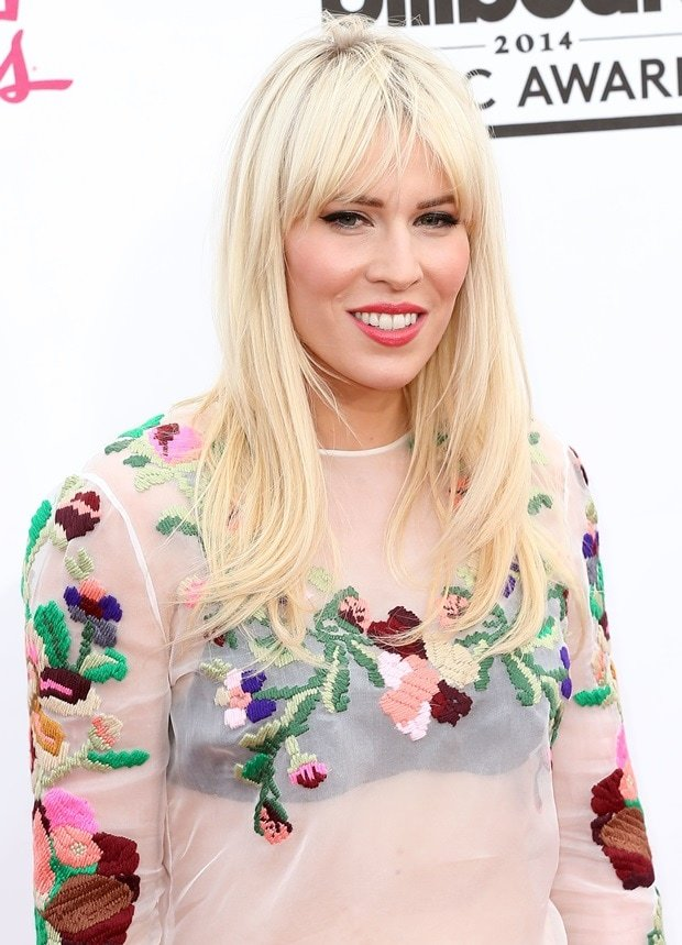 Natasha Bedingfield sported a sheer white top from the Valentino Resort 2014 Collection featuring floral appliques