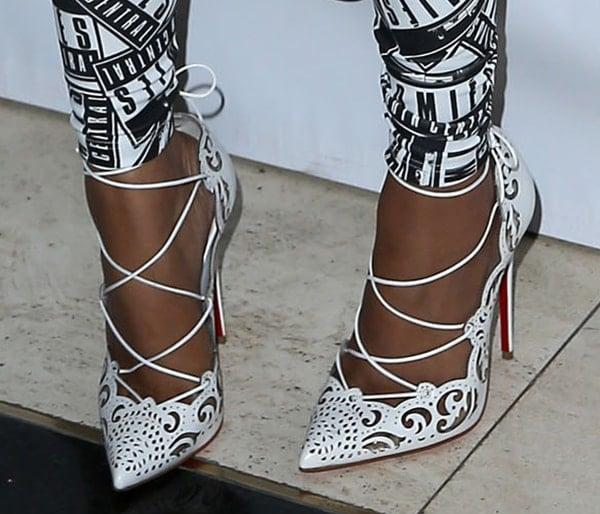 Nicki Minaj wearing the white version of the Christian Louboutin Impera pumps