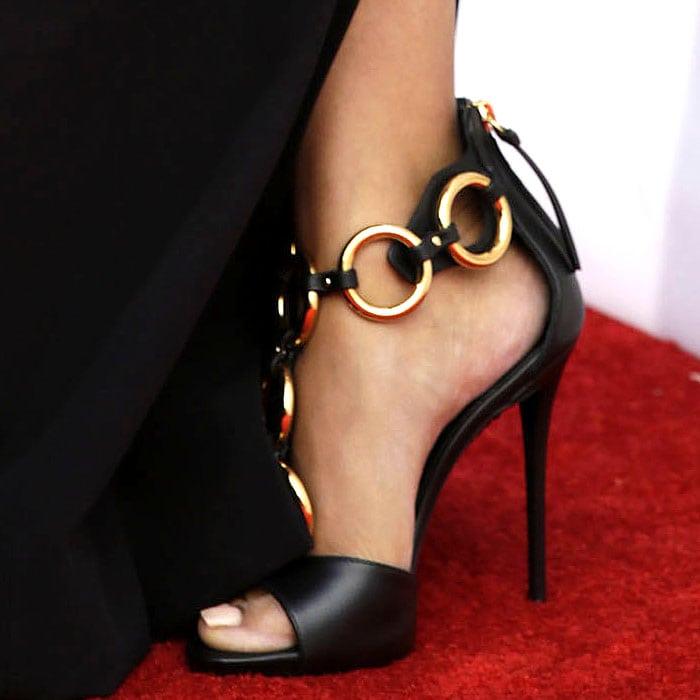 Nicki Minaj wearing Giuseppe Zanotti gold-ring leather sandals