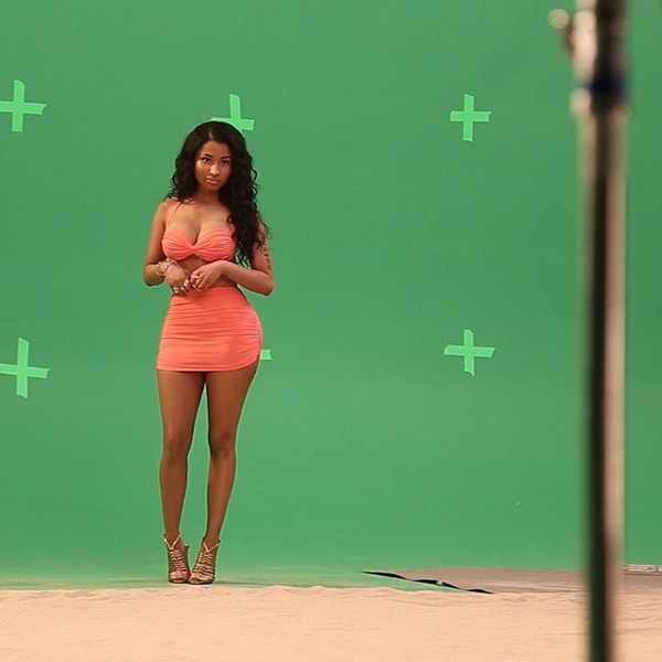 Nicki Minaj wearing a Norma Kamali swimsuit for the Myx Fusions Moscato beverage commercial