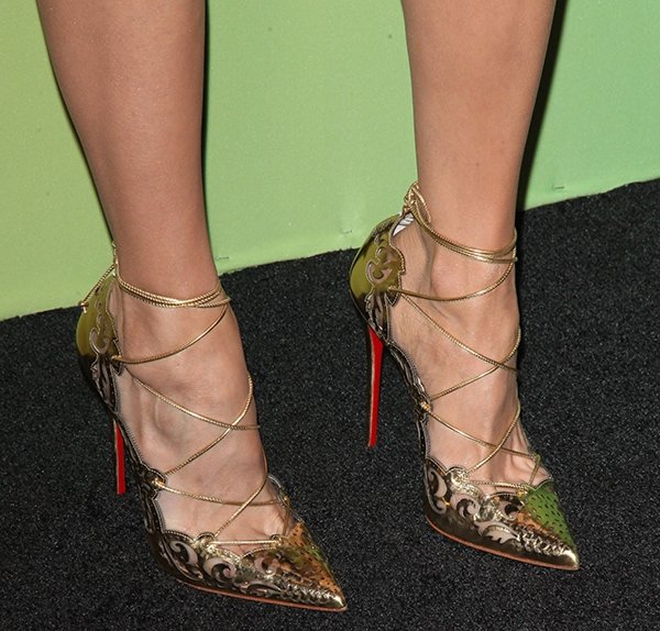 Nina Dobrev wearing gold specchio Christian Louboutin Impera pumps