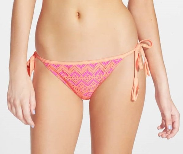 A delicate crocheted overlay sweetens string bikini bottoms that are low-rise and high style