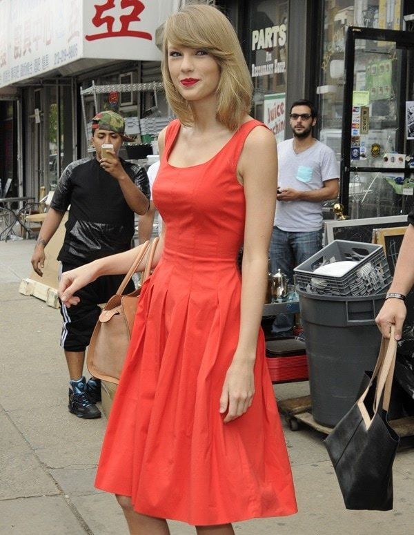 Taylor Swift's vermilion red cotton-blend A-line dress from Oscar de la Renta