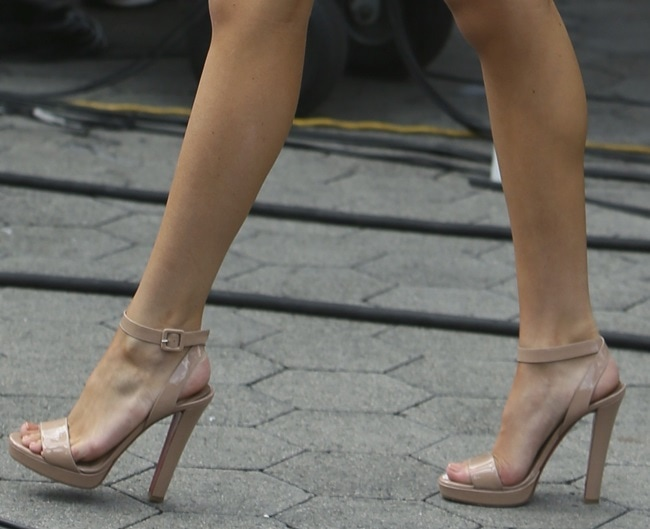 Bella wearing Echasse ankle-strap sandals in nude patent