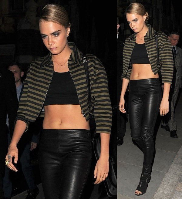 Cara Delevingne arrives with her hair in a sleek bun at an exclusive party