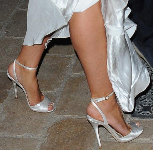 Heidi Klum wearing ankle-wrap sandals