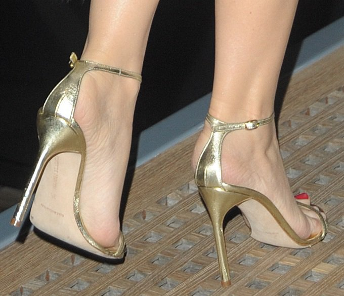 Kylie Minogue wearing glam golden ankle-strap sandals
