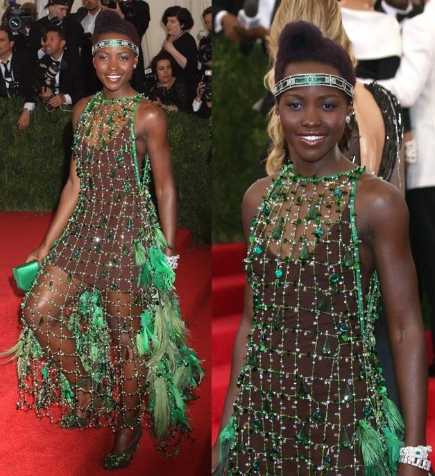Lupita Nyong'o taking huge risks with her strange Prada outfit at the 2014 Met Gala held at the Metropolitan Museum of Art in New York City on May 5, 2014