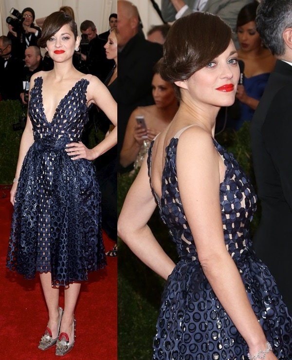 Marion Cotillard kicking it up a notch by wearing Dior Haute Couture at the 2014 Met Gala held at the Metropolitan Museum of Art in New York City on May 5, 2014