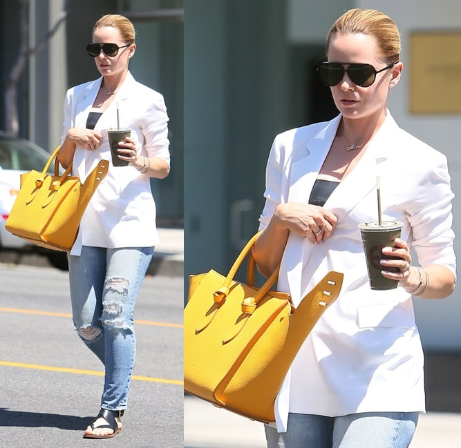 Mena Suvari looking quite chic in her white topper and flat strappies while out and about in Los Angeles