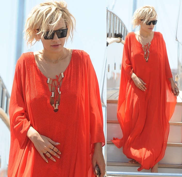 Rita Ora sports a red flowy kaftan over her bikini as she enjoys the sunny weather in Cannes, France, May 17, 2014