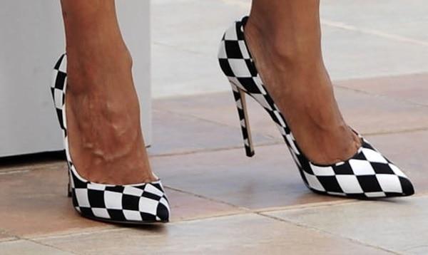 "Rosario Dawson's feet inBionda Castana ""Daphne Bis"" harlequin printed pumps"
