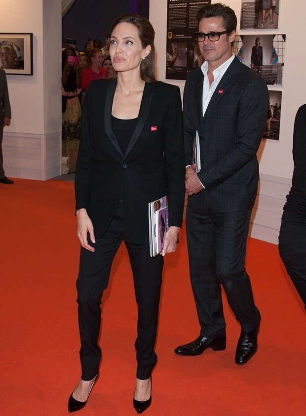 Angelina Jolie styled her black suit with matching black patent pumps